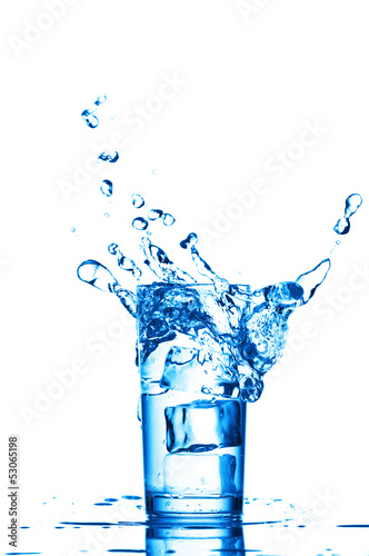 Blue water splashes in the glass on white background
