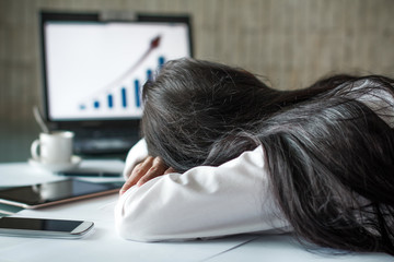 Tired businesswoman sleeping in office