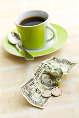 american currency and coffee cup