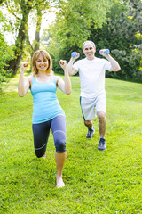 Personal trainer with client exercising