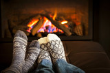 Fototapety Feet warming by fireplace