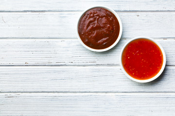 various barbecue sauces in ceramic bowls