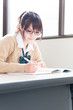 young asian school girl studying