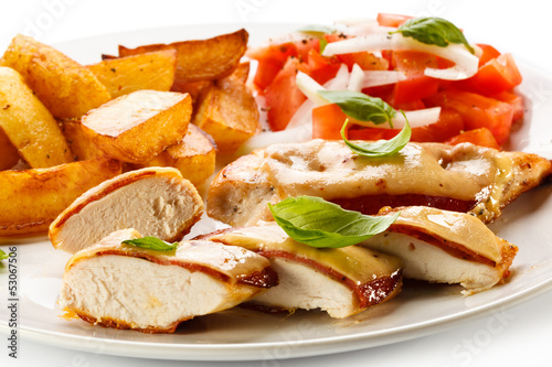 Grilled chicken breasts with cheese and baked potatoes