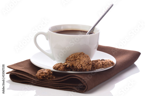 Hot chocolate in white cup on brawn table-napkin isolated on whi