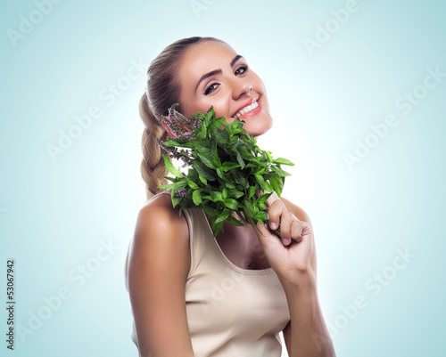 woman with a bundle of fresh mint. Concept vegetarian dieting - 53067942