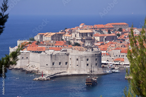 View of walled Dubrovnik old town with harbor, Croatia