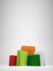 Colorful paper shopping bags on white