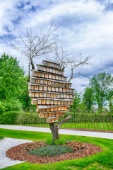 Colorful nesting boxes on a tree HDR