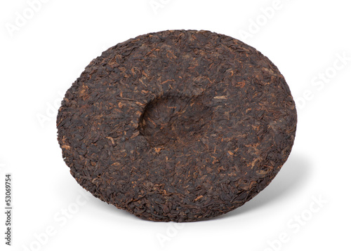 Disc of chinese puer tea isolated on a white background
