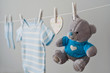 blue baby clothes on the clothesline