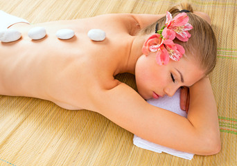 Spa massage. Beautiful young female in wellness center