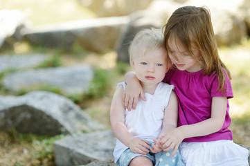 Portrait of two little sisters