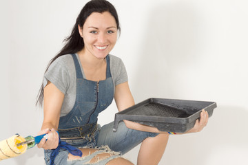 Smiling happy woman with painting equipment