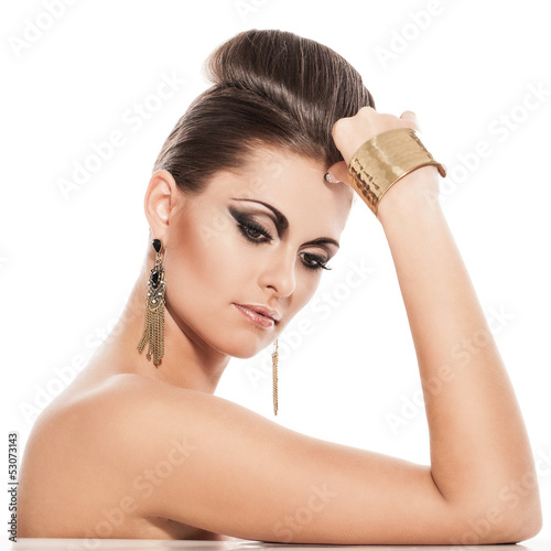 Beautiful young woman with evening makeup