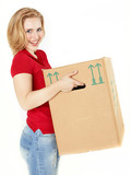 Pretty young woman carrying a moving box