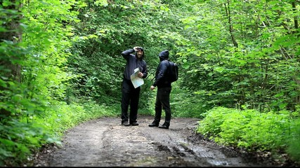 Hikers with map and binoculars on forest trails episode 1