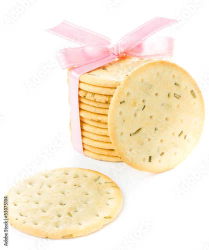Cookies with pink ribbon isolated on white background, closeup