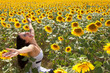 Cheerful in a sunflower field