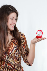girl at arm holding the ring box