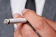 man in suit smoking - 53076776