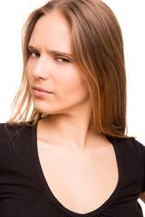 Closeup portrait of a serious beautiful woman