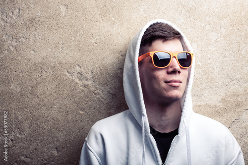 Street portrait of young boy in white sweatshirt with orange mod