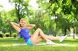 Girl in sportswear exercising in a park