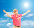Happy mature man with hat and sunglasses spreading his arms on a