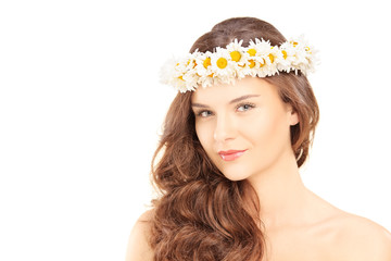 Beautiful young woman with a daisy hair wreath