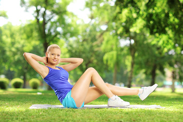 Girl in sportswear exercising in a park