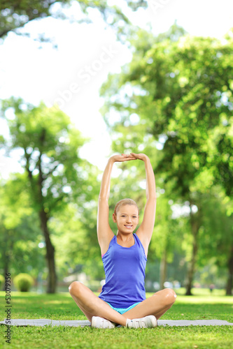 Female stretching arm in a park