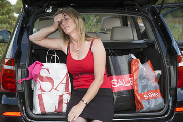 Exhausted female shopper with sale purchases