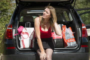 Female motorist with her carrier bags