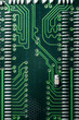 Green circuit board with binary numbers close up