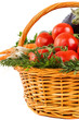 Fresh vegetables with water drops in basket