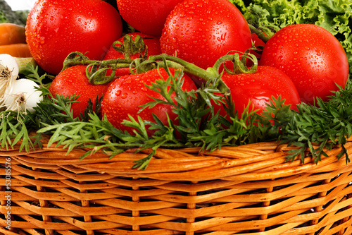 Closeup of fresh vegetables with water drops in basket