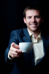 Business man giving you a coffee cup