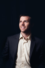Low-key portrait of a smiling business man