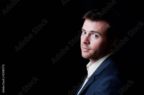 Low-key studio portrait of a business man