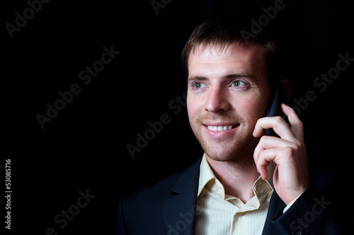 Portrait of a smiling business man talking mobile