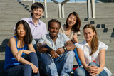 Multiethnic group of university students sitting on steps
