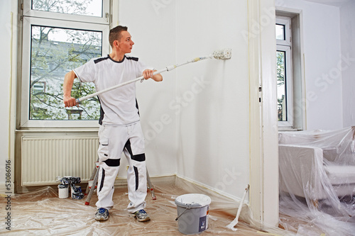 professional painter at work - 53086916