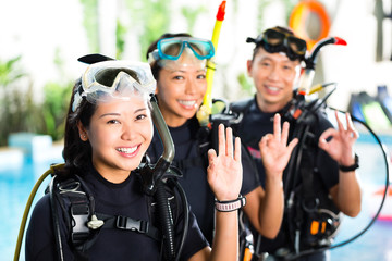People in diving school, students and master