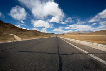 Straight road to Himalayas range, Tibet