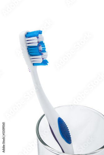 toothbrush with toothpaste in glass cup with clipping path