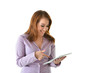 Business Woman Looking at Tablet and Laughing