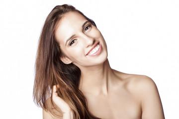 Happy woman touching hair