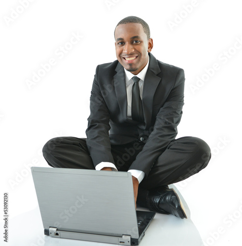 Businessman Sitting on Floor Working on Laptop