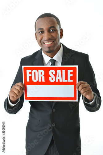"Salesman Holding ""For Sale"" Sign"